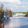 Crabber boats and ship in Greetsiel harbor - northern of Germany — Stock Photo #38690915