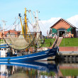 Crabber boat and Cafe in Greetsiel harbor - northern if Germany — Stock Photo