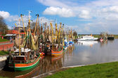 Crabber boats and ship in Greetsiel harbor - northern of Germany — Stockfoto