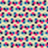 Seamless geometric pattern with colorful hearts. — Stock Vector