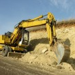 Wheel loader machine works in construction site — Stock Photo