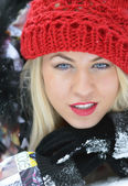 Smiling young woman with red hat — Stock Photo