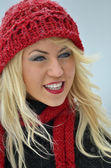 Smiling young woman with red hat — Foto de Stock
