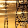 Electricity line towers against sunset sky — Stock Photo
