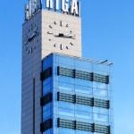 Riga central station clock tower — Stock Photo