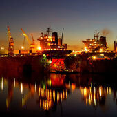 Ship are being fixed and painted at the shipyard docks by night — Stock Photo