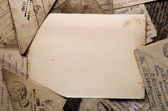 Blank letter paper on vintage postcards — Stock Photo