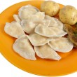 Stock Photo: Potato and mushrooms dumplings on the dish
