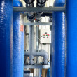 Industrial large blue tanks and water pipeline in a boiler room — Stock Photo