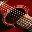 Red acoustic guitar close-up — Stock Photo