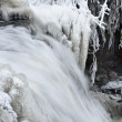 Waterfall in winter with beautiful icicles — Stock Photo
