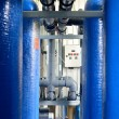 Industrial large blue tanks and water pipeline in a boiler room — Stock Photo #32822387