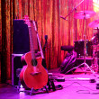 Guitar and other musical equipment on stage before concert — Stock Photo