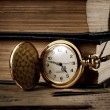 Vintage pocket clock and old books — 图库照片