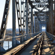 Old vintage railway bridge over river — Stock Photo #32827223