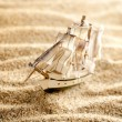 Wooden sail ship toy model in the sea sand close-up — Foto Stock