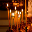 Candles burning in Orthodox church in the dark — Стоковая фотография