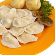 Potato and mushrooms dumplings on the dish — Stock Photo #32829635