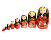 Russian traditional toy dolls matryoshka standing in row isolate — Stock Photo