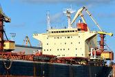 Cargo ship loading in cargo terminal — Stock Photo