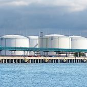 Large oil fuel tanks in the port of Ventspils — Stock Photo