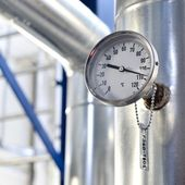 Industrial thermometer in boiler room — Stock Photo