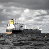Cargo ship sailing in stormy weather near port of Riga — Stock Photo