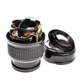 Broken plastic zoom lens isoletaed on white — Stock Photo