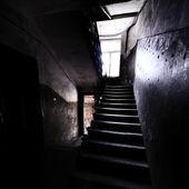 Old staircase in dramatic light — Stock Photo