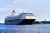 Black cruise liner leaving the port of Riga — Stok fotoğraf