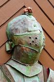 Knight steel armor on a wooden door — Stock Photo