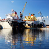 Ship are being fixed and painted at the shipyard docks — Stock Photo