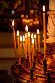 Candles burning in Orthodox church in the dark — Stock Photo