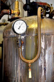 Thermometer close-up in old rusty industrial boiler room — Stok fotoğraf
