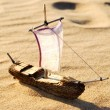 Wooden sail ship toy model in the sea sand — Stock Photo #32831041