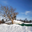 Stock Photo: House in winter with large snowdrifts