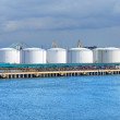 Large oil fuel tanks in the port of Ventspils — Stock Photo #32831297
