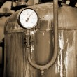 Thermometer close-up in old rusty industrial boiler room — Stock Photo