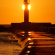Lighthouse silhouette at the sunset — Stock Photo #32833179