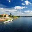 General view on Riga embarkment and river ships in bright sunny — Lizenzfreies Foto