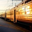 Stock Photo: Trains at the station at the sunrise