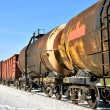 Grunge cargo train on the move in winter — Stock Photo