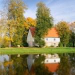 House at the lake bank in autumn. Sigulda, Latvia — Stock Photo #32835491