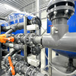 New plastic pipes and colorful equipment in industrial boiler room — 图库照片