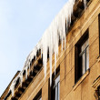 Icicles on the roof of the house — Stock Photo