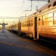 Trains at the station at the sunrise — Stock Photo