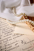 Vintage scene. Old letter with some jewelry — Stock Photo