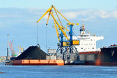 Cargo ship loading in coal cargo terminal — Stock Photo