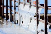 Group of icicles on the pier in winter — Stock Photo
