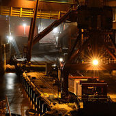 Industrial night scene at the cargo port — Stock Photo